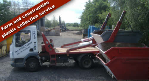 Skip lorry picking up farm and construction plastic collection service