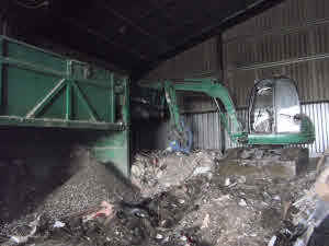 Digger in the Public and trade Waste Centre