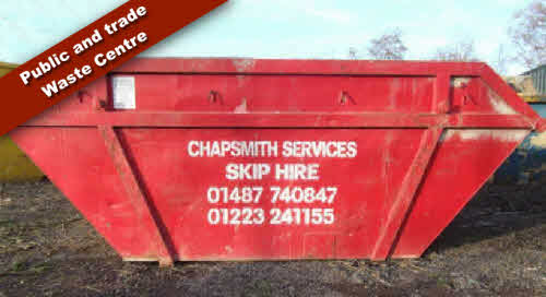 Red empty Skip for hire